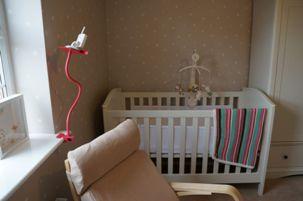 Baby monitor over child's crib