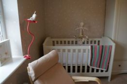 Baby monitor over child's crib