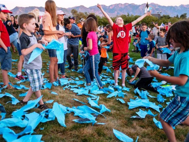 children tearing up covid masks